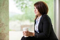 Enjoying my coffee break. Gorgeous young businesswoman relaxing and enjoying a cup of coffee at work Royalty Free Stock Photos
