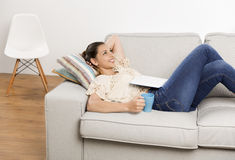 Enjoying my day. Beautiful woman with a dreamer expression enjoying her day at home Stock Photos