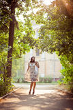 Enjoying the nature. Young woman arms raised enjoying the fresh air in green forest Royalty Free Stock Photos