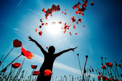 Enjoying the nature. Girl stands in poppy field Royalty Free Stock Photography