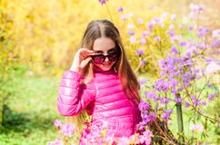 Enjoying nature in garden. Kid cute fancy child spend time in park. Plants grown for display to public. Pleasant royalty free stock photos