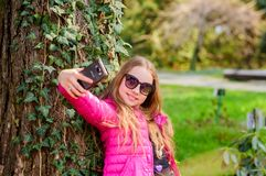 Enjoying nature in garden. Peaceful environment garden. Kid cute fancy child spend time in park. Plants grown for. Display to public. Pleasant relaxing walk in royalty free stock image