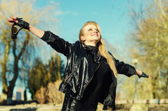 Enjoying the nature and life. Young woman arms raised enjoying t royalty free stock photos