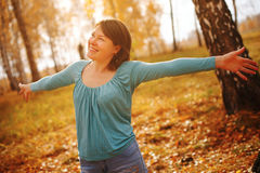 Enjoying the nature. Young woman arms raised enjoying the fresh Royalty Free Stock Photos