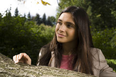 Enjoying the nature. Young woman enjoying the fresh air in green forest. Lifestyle concept real girl outside Stock Photos