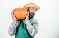 Enjoying new great day. seasonal vitamin. organic food. happy halloween. healthy product. man with pumpkin. bearded man. Farmer hold big squash. harvest stock photo