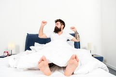 Enjoying nice morning. energy and tiredness. asleep and awake. brutal sleepy man in bedroom. bearded man hipster sleep stock photos