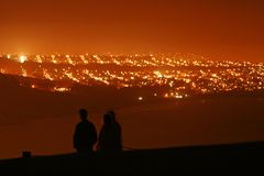 San Francisco at night. Scenic view of San Francisco city at night with silhouetted people on hill in foreground, California, U.S.A Royalty Free Stock Photo