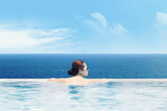 Enjoying ocean view from the infinity pool Stock Images