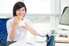 Enjoying office meal Stock Images