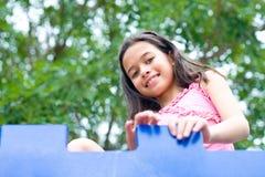 Enjoying the outdoor playground Royalty Free Stock Image