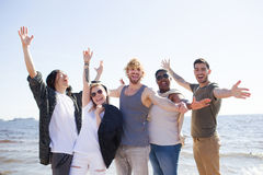 Enjoying party. Happy friends having fun and enjoying party by seaside on weekend Stock Photos