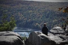 Enjoying the Peace and Quiet on a Rocky Outcrop royalty free stock photography