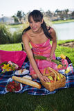 Enjoying picnic. Beautiful woman enjoying late afternoon picnic Stock Image