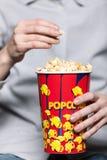 Enjoying popcorn Royalty Free Stock Photography
