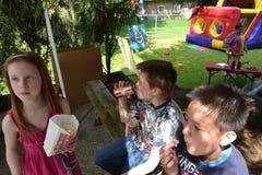 Enjoying popcorn outside Royalty Free Stock Images