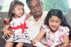 Enjoying reading book together Royalty Free Stock Image