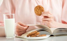 Free Enjoying Relaxing Moment With A Book, Cookies And Milk Royalty Free Stock Images - 116006479