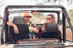 Enjoying the ride. Family enjoying their ride in the off-road vehicle royalty free stock image