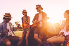 Enjoying road trip with friends. stock photos