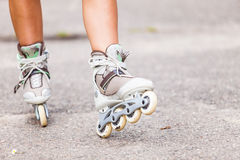 Enjoying roller skating rollerblading on inline skates. Royalty Free Stock Image