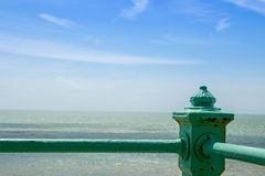 Enjoying a seaside view from the shore Stock Images