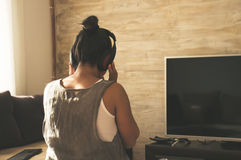 Enjoying the silence. Girl listening to music at home Stock Photography