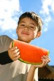 Enjoying a slice of watermelon Stock Photo