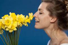 Enjoying the smell of flowers Stock Photos