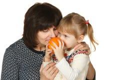 Enjoying the smell of the orange Stock Image