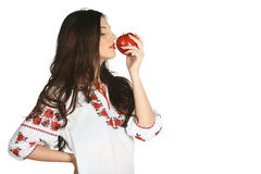Enjoying the smell of red apple Royalty Free Stock Photos
