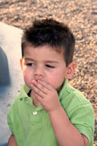 Enjoying A Snack 2. Young boy eating a snack outdoors stock photo