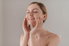 Enjoying the softness of her skin. Stock Image