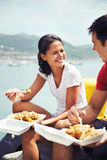 Enjoying some fish and chips together at the harbour Royalty Free Stock Photo