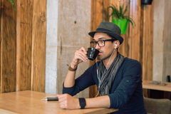 Enjoying some music and coffee Royalty Free Stock Photography