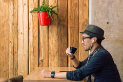 Enjoying some music and coffee Royalty Free Stock Photos