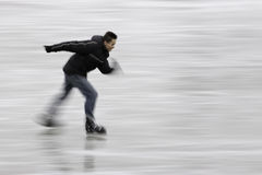 Enjoying speedy ice-skating royalty free stock photo