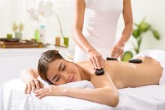 Enjoying stone massage Stock Images