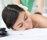 Enjoying stone massage Stock Photos