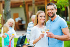 Enjoying summer barbeque with family. stock images