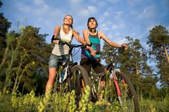 Enjoying summer day. Couple of cyclers on their bikes in the countryside on hot summer day Stock Photo