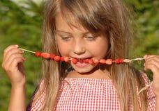 Enjoying summer fruit Royalty Free Stock Image