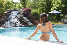 Enjoying summer at the pool Royalty Free Stock Photos