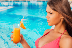 Enjoying summer by the pool. Royalty Free Stock Photos