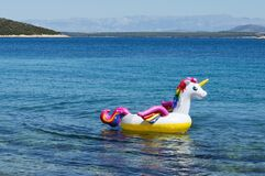 Inflatable unicorn floating in the sea