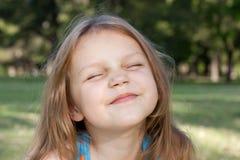 Enjoying the sun. Little girl enjoying the sun in the park Royalty Free Stock Photos