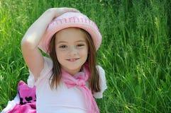 Enjoying the sun. Girl with pink straw hat enjoying the sun Royalty Free Stock Photos
