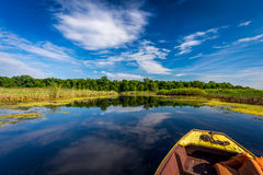 Enjoying the sunny day on a lake. Fishing from a kayak on a small lake in Serbia Stock Photography