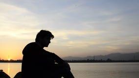 Enjoying sunset at lake stock video