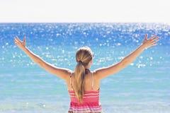 Enjoying the Sunshine. A beautiful Young Woman soaking up the warm beautiful sunshine at the beach Royalty Free Stock Image